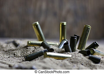 bullet in the sand - concept of global crime machine...