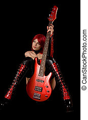 Fetish model with bass guitar, isolated on black background
