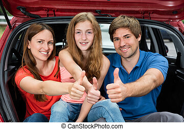 Cheerful Family Showing Thumbs Up - Cheerful Family Sitting...