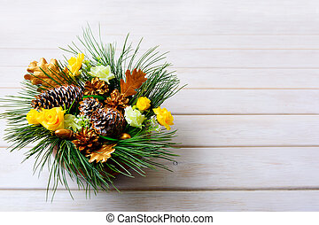 Christmas table centerpiece with pine branches and golden fir cones