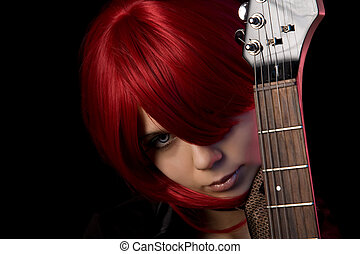 Vampire girl with guitar, focus on face