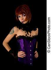 Young girl in purple corset