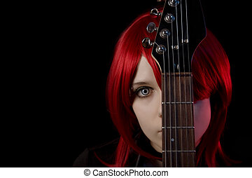 Gothic girl wearing scary lenses with guitar, selective...
