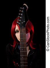 Gothic girl with guitar, selective focus on guitar, isolated...