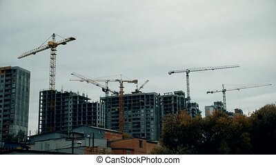 Time lapse of constuction site with cranes - Time lapse of...