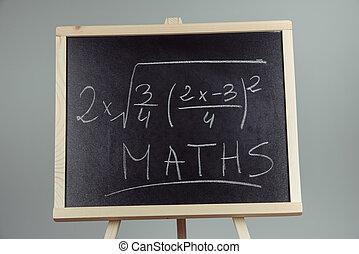 Math exercise on chalkboard