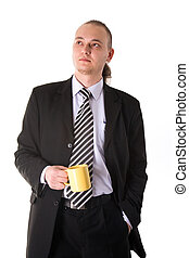 Serious looking businessman holding coffee cup isolated on...