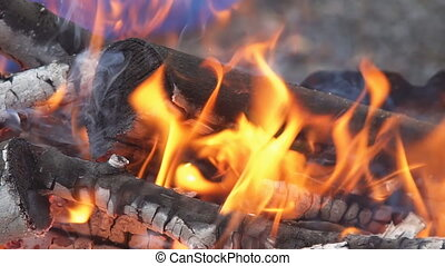 Fire burning in slow motion with wood falling wood fire Slow...