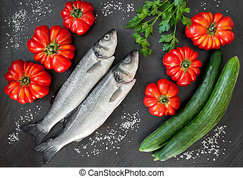 Sea Bass And Vegetables - Fresh sea bass with tomatoes,...