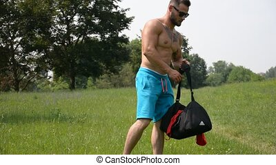 Handsome Muscular Hunk Man Outdoor in City Park, During...