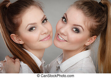 Lovely playful sisters women portrait. - Family and...