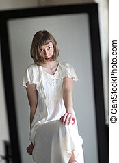 Beautiful Woman in a White Dress in Reflected in a Mirror -...