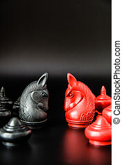 Black and Red Knight Thai chess piece challenge on black background and selective focus