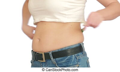 woman measures her belly. woman with the fat on the belly -...