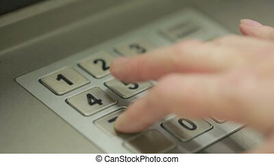 man hand touching ATM machine. gaining password. - Human...