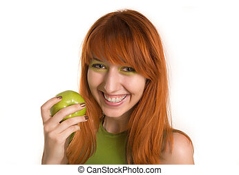 Smiling red-haired girl with green apple