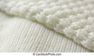 white knitted wool texture. use as background. close-up -...