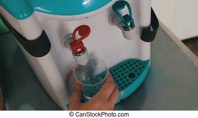 Using Water Dispenser - Filling Cup At Water Cooler, Water...