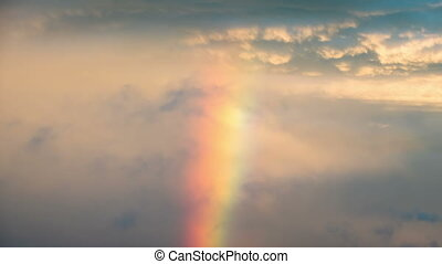 Clouds in the Sky and Rainbow are Moving. Time Lapse -...