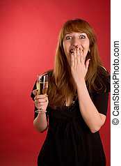 Surprised girl with champagne glass