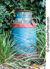 Old buckets milk, beautifully painted but rusting in nature