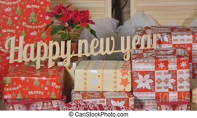 Happy New Year! - wooden text on new year gifts. - Happy New...