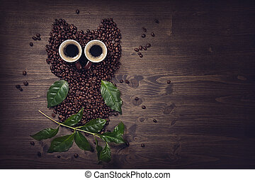 Coffee owl from beens, leaves and cups