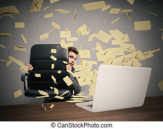 Scared by too many email - Scared businessman hidden behind...