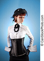 Beautiful girl in Victorian style clothes, studio shot over...
