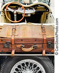 Veteran car - cabriolet with suitcase