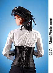 Rear view of beautiful girl in Victorian style clothes,...