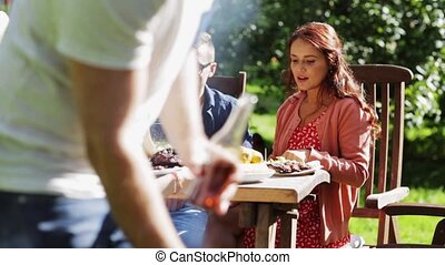 happy friends at barbecue party in summer garden - leisure,...
