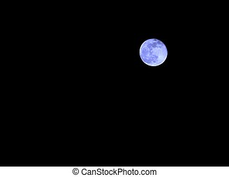 blue moon in the dark night without stars - magical blue...