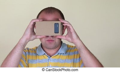 Guy touching air with virtual reality glasses. Closeup shot....
