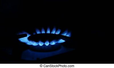 Domestic gas stove is lit blue video gas - Domestic gas...