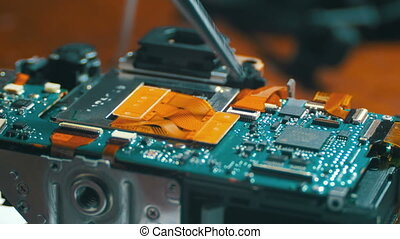 Radio Engineer Repairing Electronic Circuit Board