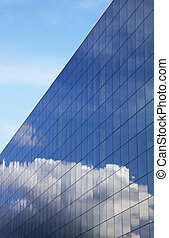 Modern office building and blue sky reflection - Modern...