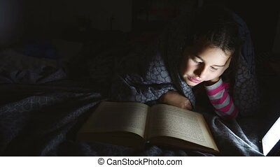 girl teen child book reading night with flashlight lying a...