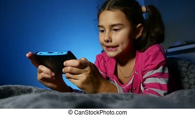 teen girl playing kid portable video online game a console...