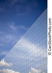 Office building and blue sky reflection