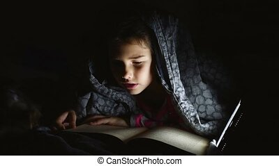 reading teen girl child reads book reading at night with...
