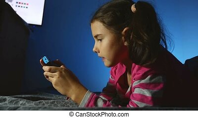 teen girl playing portable kid video online game a console...