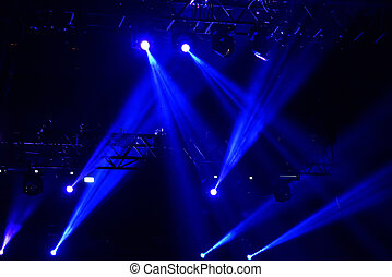 Stage lights. Light projectors in the dark