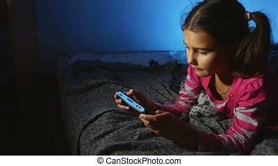 teen girl playing portable video game a online console kid...