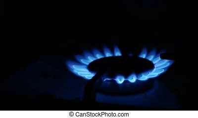 Domestic gas video stove is lit blue gas - Domestic gas...