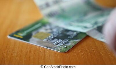 Credit card is a plastic video man counts money - Credit...