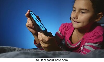 teen girl kid playing portable video online game a console...