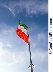 Italian Flag with Pole on Blue Sky with Clouds