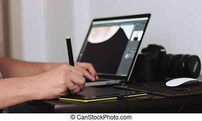 Person using laptop - Cropped hands drawing on digitizer...