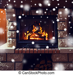 close up of burning fireplace with snow - winter, christmas,...
